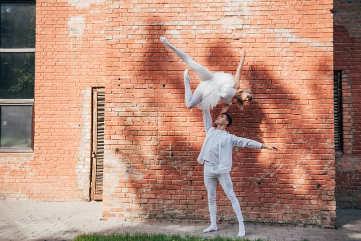 beautiful-young-couple-of-dancers-performing-ballet-dance-on-city-street