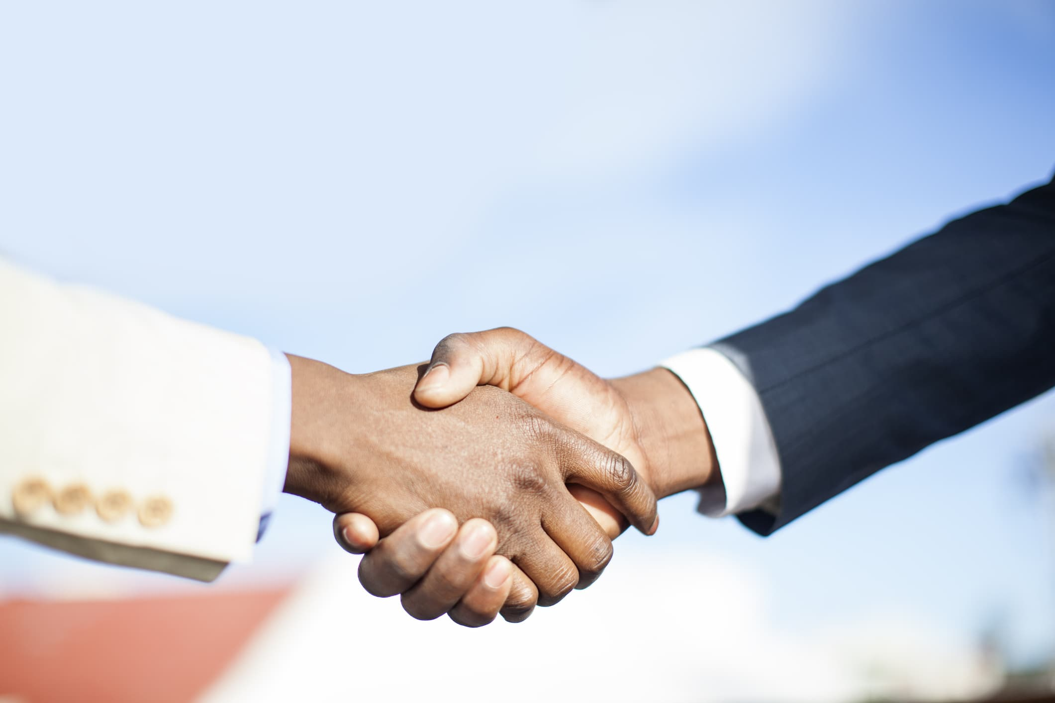 close-up-of-two-businessmen-shaking-hands-south-africa